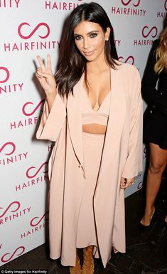 Trending Fashion Style: High-waisted Skirt. -Kim Kardashian in Juan Carlos Obando Spring 2015 rustic pink crop top + cover-up + high-waisred skirt ensembleat the Hairfinity UK Launch in London, Nov 2014.