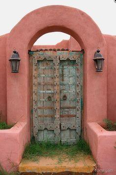 Spanish style door in pink adobe wall. Must be wondrous treasures behind that door Grand Entrance, Entrance Doors, Doorway, Cool Doors, Unique Doors, Portal, When One Door Closes, Door Knockers, Garden Gates