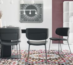 This version of the Claire dining chair by Calligaris has a matt metal frame in either black, taupe, optic white, grey or a chromed frame. The leather upholstered seat has a large wide curved backrest reminiscent of the Nordic tradition. The leather seats are available in black, grey, taupe or optic white depending on the frame colour. Part of the Claire range see related products. Made in Italy</p><br />