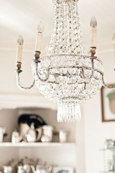 Paris Hotel Boutique home tour -Lynn first fell for the old-hotel feel of this antique French chandelier, which fits perfectly in her breakfast nook.