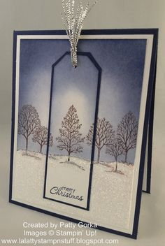 Dazzling diamonds glitter on the fresh snow makes this card just SPARKLE! A navy border and Lovely as a Tree stamp add the unique tag to this handmade Christmas card.