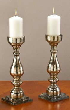 The brown mercury glass and black base make a dramatic presentation and elegantly enhance the candlelight.