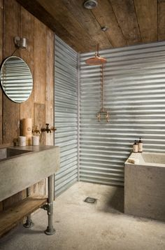 Bath with corrugated metal and stone. | Get Ready to Fall In Love with This Gloriously Rustic Tiny Cabin | Tiny Homes