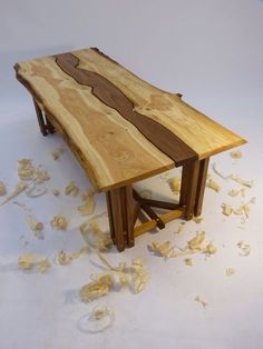 #tables Interesting use of a walnut filler board custom cut to match the natural edges of the oak planks. And the hayrake base is nice.