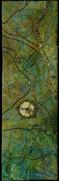 I ❤ beading & machine embroidery . . . Chaos of Creation~ From the Rocks & Water Gallery. Size in inches: 5¾ x 18¼ Mounted size: 9 x 22 inches. In the private collection of George Wilson & Claire McClenny. ~By Larkin Jean Van Horn  Techniques used:  machine stitching, hand beading  Materials:  hand-dyed cotton and silk organza; stone donut cabochon; glass seed and bugle beads; pressed glass beads