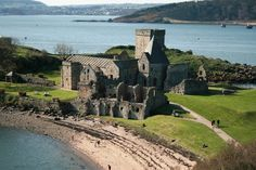 Inchcolm Abbey - [ In the Firth of Forth (the bay or estuary or fjord of the Forth river) near Edinburgh Scotland. It's on Inchcolm Island and you'll see it from a tour boat, ship or ferryboat. The Abbey is interesting because it was built 2 years before the invention of dirt, and the island is beautiful enough to make a visit worthwhile anyway. - PSC]