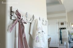 AS Photoshoot: Apron strings hanging on spoon hooks,    DIY Spoon  Pallet Hook Rack | The Wood Grain Cottage