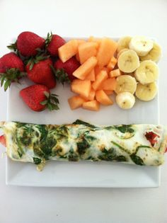 Healthy breakfast: fruit, egg white, spinach, tomato wrap    Looks like my kind of breakfast! :)