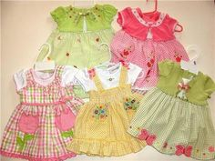 A gorgeous lot of baby girl dresses size 12 months from Youngland, so cute!!!