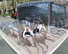 The Breeders' Cup commissioned Kurt Wenner, to create this 3d painting that depicts a scene from Santa Anita Park. It's 32 feet long by 16 feet wide, with an accompanying 10-foot high decorated wall.