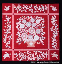 Blooming Doilies quilt by Rachel Daisy.  Judge's Commendation. 2015 Sydney Quilt show.  Embellished with doilies and yo yos.