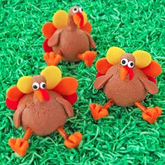 Chocolate peanut butter fudge turkey treats for Thanksgiving decorated with modeling chocolate.