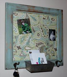 old cupboard door turned into a bulletin board... nifty!