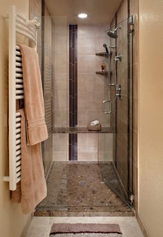 Snuggle in warm towels from this #bathroom designed by Lifestyle Kitchen & Bath Center @KitchenBathChan.... perfect for basement with the basement sink
