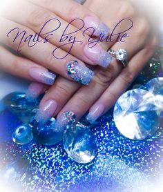 Silver glitter fading with natural color. I added  royal blue diamonds.   Simple nails