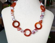 A personal favorite from my Etsy shop https://www.etsy.com/listing/268881115/carnelian-donuts-and-crab-agate-necklace
