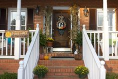 The wreath I made (idea from Shanty2chic blog) and my front porch decorations for fall.