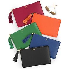 Our personalized Colorful Leather Large Carry-All Pouches have a tassel zipper pull and perfectly fit into a purse or can be carried alone. Foil stamp the pouch with your initials or a fun three-letter word. Made with genuine leather. https://www.thingsremembered.com/product/Colorful-Leather-Large-Carry-All-Pouches/176935.uts