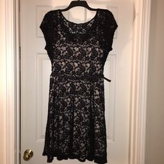 Black lace cocktail dress Large Black lace cocktail dress size large. Never worn but with out tags. Purchased from Macy's. Comes with a black braided belt (removable). The underneath slip is a light off white/light tan color. Please use offer button for negotiations. I will not agree to price in comments. Thank you! Dresses