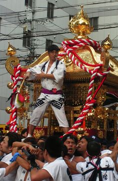 A portable shrine procession at the Tenjin Matsuri