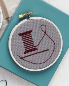 Reflect your passion for sewing with a small-scale design.  Print the Cross-Stitch Needle and Thread Clip Art