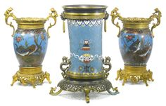 AN ASSOCIATED CHINOISERIE GILT BRONZE MOUNTED CLOISONNÉ ENAMEL THREE PIECE TABLE GARNITURE FRANCE, LATE 19TH CENTURY, THE SINGLE VASE, CHINESE WITH MOUNTS BY FERDINAND BARBEDIENNE