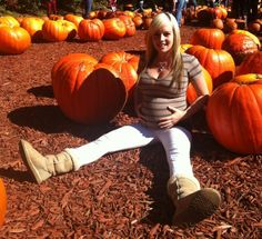 29 weeks pregnant and smuggling a pumpkin out of the pumpkin patch in October!