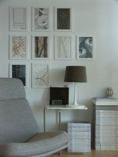 co-ordinating wallpapers in white picture frames - good way to get pattern into an interior without the need to wallpaper