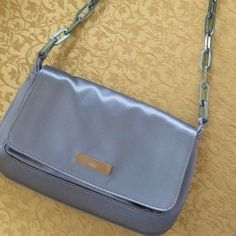 Authentic blue satin Gucci handbag Gorgeous blue satin Gucci handbag. This bag has a beautiful  blue chainlink...which is uniquely stunning. This bag is vintage and has no serial tag but is definitely authentic...part of the evening edition and in great condition. Gucci Bags