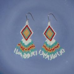 These Native American inspired earrings are made from tiny glass seed beads and Sterling Silver ear wires. They measure approx. 7/8 across and 2 5/8 down from the first beads to the end of the fringes.  Most of my beaded earrings take 2-3 hours to make and are made from top quality materials.  To see more of my beaded earrings, hoop earrings, leather wrap bracelets, beaded ornament/sun catchers and gift items. please visit my shop at www.etsy.com/shops/heartfeltbeadin...