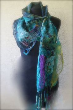 This scarflette/shawlette is in-between a scarf and small shawl or can be a cowl neck. It is made out of silk chiffon 6mm print and shimmering silk hobatai. There are also quite a few ruffles along the edges made out of silk organza and has nuno cording at one end the other end has