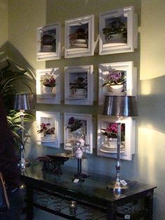 shadow boxes with african violets and teacups
