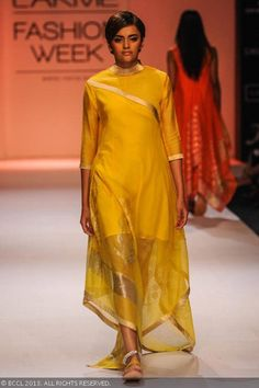 A model showcases a creation by designer Rahul Mishra on Day 5 of the Lakme Fashion Week (LFW) Winter/Festive 2013, held at Grand Hyatt, Mumbai, on August 26, 2013.