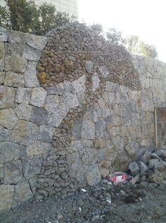 Stone wall. basalt stone wall.may be i'm think pine tree.