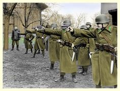 With a supervisor looking on, a group of Honved infantrymen practice the Luftwaffe, Paratrooper, Ww2 Uniforms, Germany Ww2, Military Pictures, European History, Budapest Hungary, Eastern Europe, World War Two