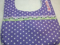 Purple Baby Bib - Purple and White polka Dots with a Purple and Green floral ribbon trim. Very Cute! by ButterflyBlessing on Etsy https://www.etsy.com/listing/269459070/purple-baby-bib-purple-and-white-polka