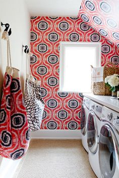 Love this wallpaper and the laundry bags made out of the same fabric as the wallpaper adds a nice touch.
