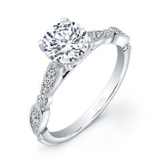 """Antique-inspired round diamond engagement ring in 14K white gold, made to fit a 1-carat center,featuring a breathtaking milgrain-edged upper shank that holds 4 bezel-set rounds interspaced with trios of smaller rounds pave-set in marquis-shaped frames; this ring features Uneek's signature """"tri-fluted"""" bottom shank; from Uneek's bestselling Unity Collection; matching band available, with style number UWB014"""