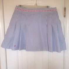 """RARE White Label Lilly Pulitzer SKORT RARE White Label Lilly Pulitzer Blue & White Striped Seersucker Skort with adorable pink """"L"""" Palm Tree stitched on bottom right.  Worn 2x & in pristine condition when vacationed in Charleston/Savannah. Just realized I'm not going to fit back into after the baby ;(  Size 6  Although I think it runs a tad larger than the current sizes. I believe an 8 might fit if waist is 29-30"""". Lilly Pulitzer Skirts"""