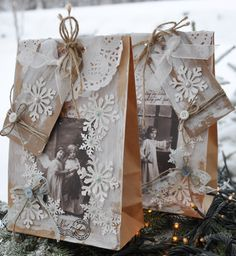 Love this christmas wrapping ... no directions available but you can think it out.. The snowflakes were available at Michaels last year in the scrapbook supplies.