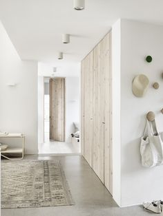 The natural home | French By Design - white walls, light colored wood and polished concrete floors