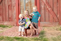 Three siblings poses - older sister & two brothers