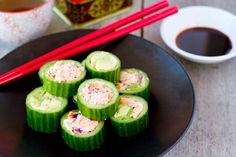 Simple sushi; hollowed out zucchini or cucumber rings instead of trying to wrap the sushi. Paleo-friendly avocado and salmon recipe.