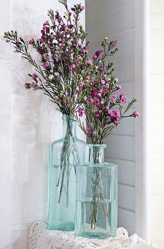 pretty flowers in bottles