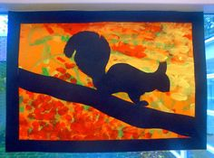 Students use red, green, and yellow paints to paint on orange paper; then glue silhouette on top! Squirrel, owl, whatever!