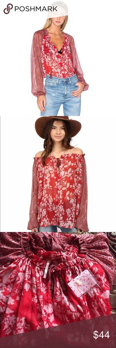 NWT Free People Red Hendrix Sheer Floral Blouse Free People Sheer Hendrix Off Shoulder Or On Blouse  Sensuality, elegance and luxury all wrapped up in this pretty sheer peasant blouse. Optical illusion that carves a beautiful silhouette be on your shoulders or off your shoulders creating a boho look of relaxed, easy elegance.  100% nylon Keyhole front with tie closure Tassel fringe trim with bead embellishments. Size M Free People Tops Blouses