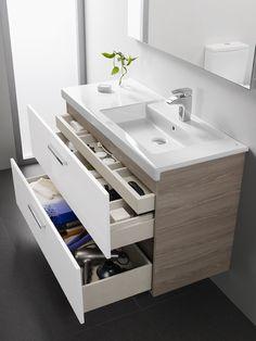 PRISMA, le nouveau mobilier de salle de bain de chez ROCA. Vasque asymétrique, jolis tiroirs façade laqués blanc et côtés bois, un contraste réussi, esthétique et graphique.