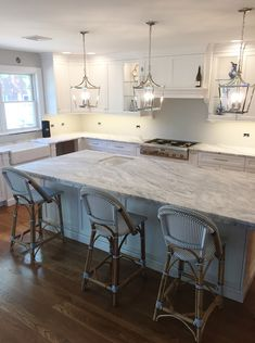Classic white kitchen with stunning Mont Blanc Honed quartzite countertops. The island has a unique stepped-back laminated edge profile to make it appear thicker & give visual interest. Kitchen by Stoneshop from Cherry Hill, NJ.