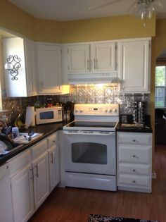 Rustoleum Countertop Paint Onyx : ... Cabinet transformations, Countertops and Traditional white kitchens
