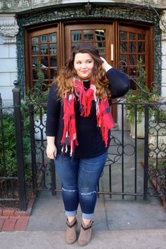 cable knit sweater, button down back sweater, red plaid scarf, fringe scarf, holiday style, natalie craig, natalie in the city, chicago, plus size fashion blogger, plus size, jeans with holes in the knees, taupe ankle boots with a brown strap, ankle booties, how to wear ankle boots, ps fashion ootd, blogger, fashion